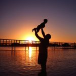 Aboriginal Father n Son Beach Sunrise Urunga NSW Australia
