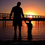 Aboriginal Father n Son Sunrise Scene Urunga NSW Australia
