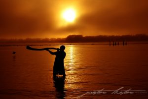 Aboriginal Playing Didgeridoo Sunrise Scene Urunga NSW Australia
