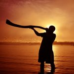 Aboriginal Playing Didgeridoo at Sunrise Urunga NSW Australia